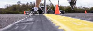 runner crossing chip timing finish at Jigsaw's annual 10k run